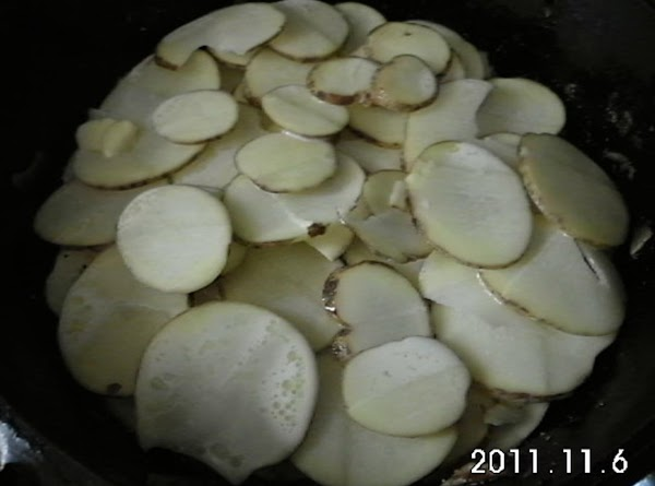 Using the same skillet the onions were cooked in, layer potatoes in bottom ...