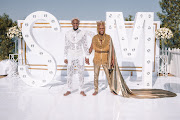 Grooms Mohale Motaung and Somizi Mhlongo in the Egyptian-inspired looks designer Gert-Johan Coetzee created for their traditional wedding in September 2019.