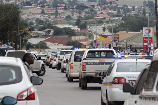 Armed police are monitoring the situation around the Mthatha CBD because of the ongoing taxi violence in the area Picture: SINO MAJANGAZA