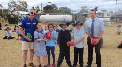 Narrabri Eagles president and player Ben Maddern, left, led an Australian rules football clinic at the Narrabri Public School last Friday. Pictured with Maddern are students Caitlyn Taylor, Melody Calsena, Brodie Fry, Kevin Condran and teacher and fellow Narrabri Eagle Travis Heffernan.