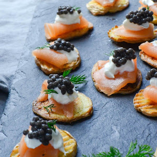 Smoked Salmon And Caviar On Crispy Potatoes.