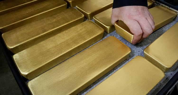 An employee stores newly cast ingots of 99.99% pure gold at the Krastsvetmet non-ferrous metals plant in the Siberian city of Krasnoyarsk, Russia. Picture: REUTERS/ILYA NAYMUSHIN/FILE PHOTO