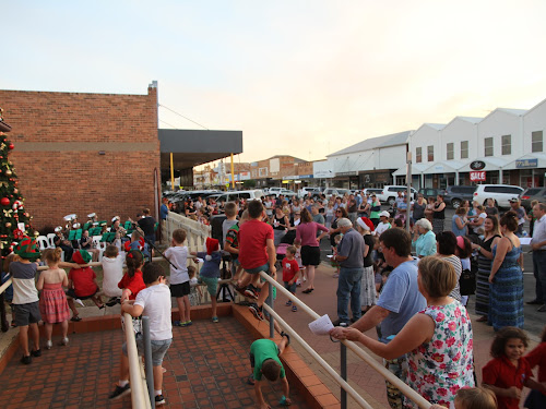 The audience gathers to see the Narrabri CBD Christmas tree lights switched on for the festive season on Thursday evening.