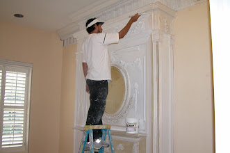 Photo: August 2006 - Month 36: Hector painting the fire place after much prep work removing layers and layers or prior years' paint