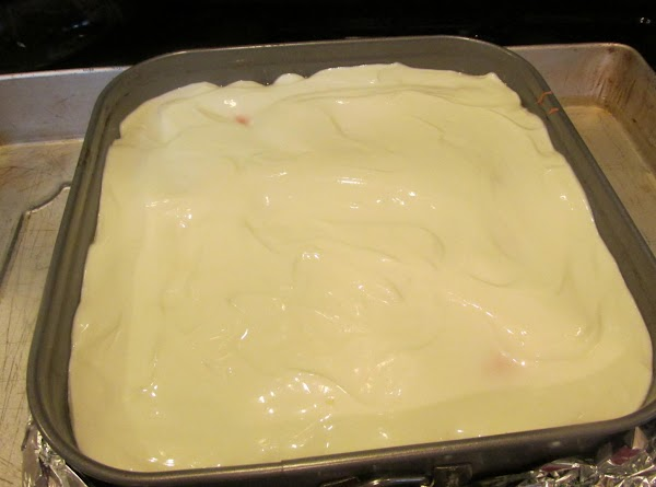 Then spoon sour cream mixture over top of cake, leaving it inside oven for...