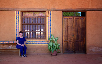 Photo: Temi in front of our hotel in a mission town