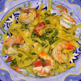 Fettuccine with Prawns, Peas, Tomatoes with Cream Sauce.