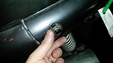 Photo: That's generally not what bolts are supposed to look like. I used a box end wrench to tighten it down as much as possible.