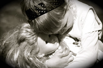 Photo: A tender moment with her beloved Dolly