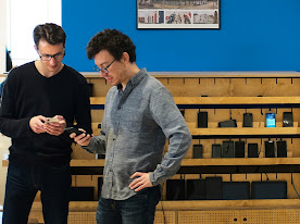 Two men looking at their phones