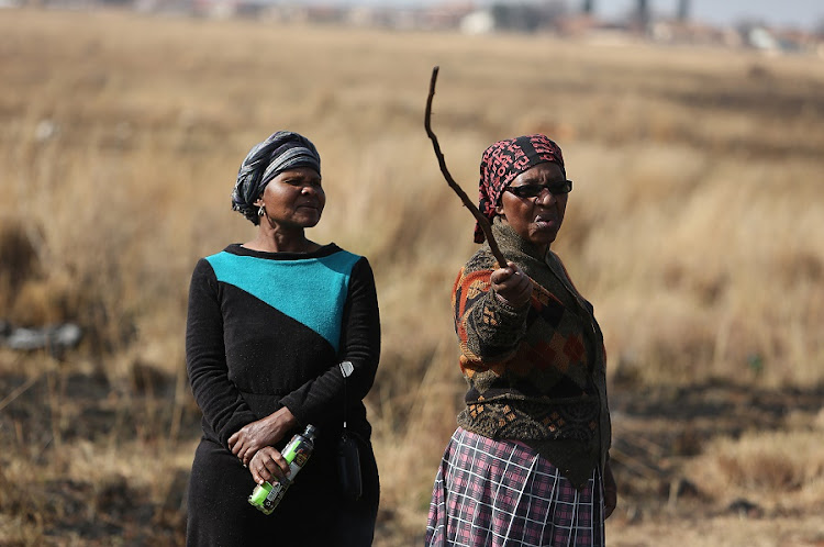 Residents of Lawley south of Johannesburg protest on Wednesday against land-grabs in the area, vowing to place the community on lockdown. Picture: ALON SKUY