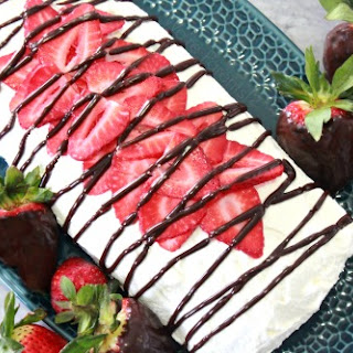 White Chocolate Strawberry Cake Roll with Homemade Fudge Drizzle.