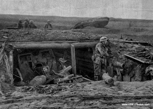 Photo: A German Gun Pit Captured By The Tank In The Background
