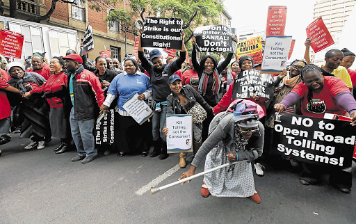 Young and old took part in protests organised by Cosatu against the e-tolling on Gauteng's highways. File photo.