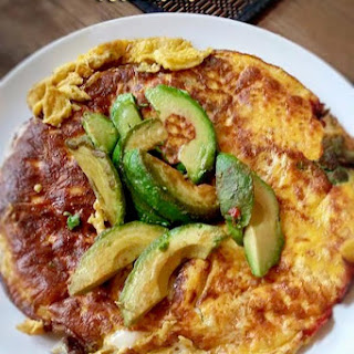 Keto Breakfast Omelet With Black Olives and Fried Avocado.