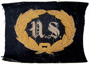 "Photo: 1884 - 1887 C. M. McCarthy Portrait not available. United States Army General and Staff officer's uniform hat insignia. The insignia reportedly belonged to General C. M. McCarthy. It consists of a felt rectangle backed with heavy paper and embroidered in bullion with a wreath and the letters ""US"".   http://collections.mnhs.org/cms/display.php?irn=10314209"