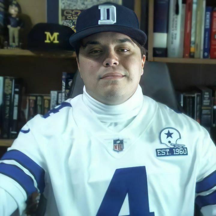 head shot of Donald in Dallas Cowboys gear.