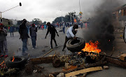 Angry residents in Alexandra township during earlier protest action over poor service delivery.