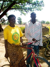Photo: Rose uses her new bike to get to her farm and to the market several miles away. She buys millet at the Kandiga market, and then resells it at another market in Sirigu, which is 10 miles away.  In Sirigu, she buys ground nuts, and sells them in the Kandiga Market.