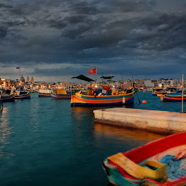 Marsaxlokk port in the evening by Michaela Firešová - Transportation Boats ( port, malta, boats, evening )