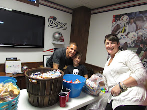 Photo: Nico with his parents Greg and Andrea helping to pack kare kits.