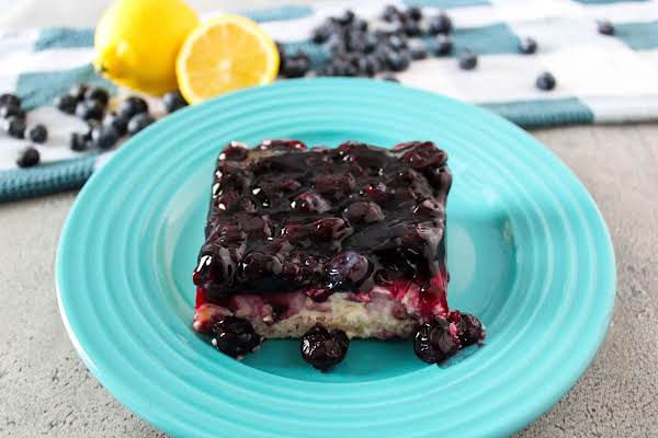 A Slice Of Blueberry Cream Cheesecake On A Plate.