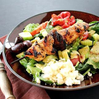 Mediterranean Salad with Grilled Chicken Skewers.