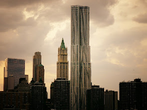 Photo: New York by Gehry framed by dramatic storm clouds.   8 Spruce Street. Financial District, New York City.  View the writing that accompanies this post here at this link on Google Plus:  https://plus.google.com/108527329601014444443/posts/K5AffkfxGai  View more New York City photography by Vivienne Gucwa here:  http://nythroughthelens.com/