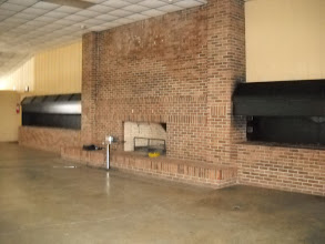 Photo: Choctaw Lake's Lodge. Those are two big grills on each side of the fireplace.
