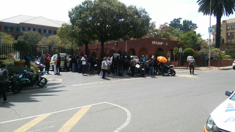 A group of protesters and journalists outside the Braam Park office park where a memorandum of demands will be handed to the CRL commission against false prophets. 14 March 2018