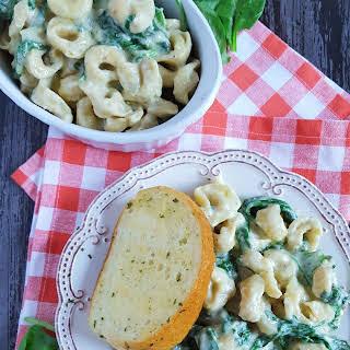 Creamy Tortellini Alfredo with Roasted Garlic & Spinach.