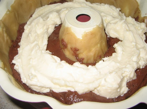 Remove bundt pan from freezer.Pour the  cake batter (less the 2 cups) into...