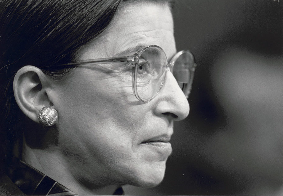 A closeup of Ruth Bader Ginsburg in black and white