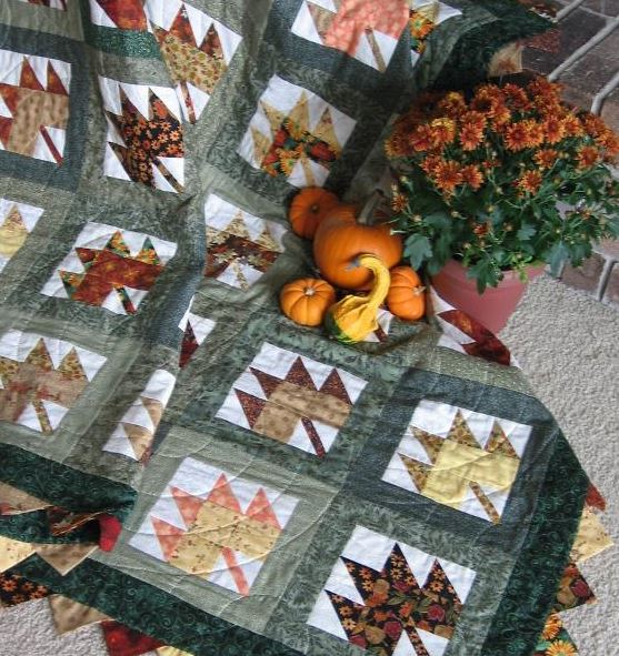 Quilt Laying on Carpet with Gourds