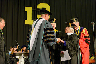 Photo: Trustee Chris Royer, Class of 1948, receives congratulations  from President Casey after being presented by classmate Lee Rice (Trustee Emeritus) for the honorary Doctor of Humane Letters.