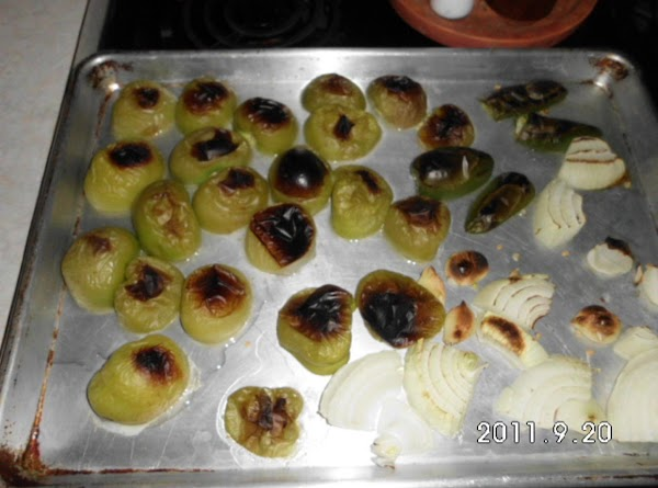 Peel and wash tomatillos and cut in half.  Cut jalapeno in half and...