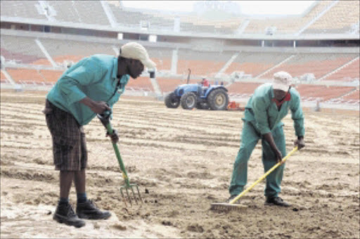 PROGRESS: Turftek workers prepare the pitch at the Peter Mokaba Stadium in Limpopo for the 2010 World Cup final in June. Pic. Elijar Muxhiana. 24/03/2010. © Sowetan.