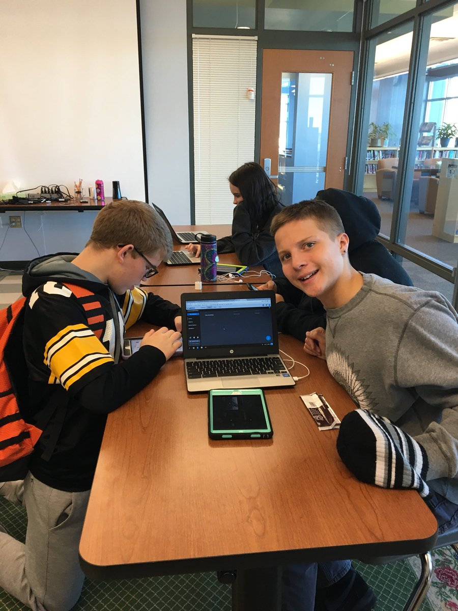 This is a picture of two students using a Chromebook, an iPad, and WeVideo software in a classroom.