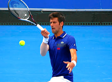 In fighting form:  Novak Djokovic on his way to victory over Dominic Thiem at the Kooyong Classic in Melbourne on Wednesday. Picture: REUTERS