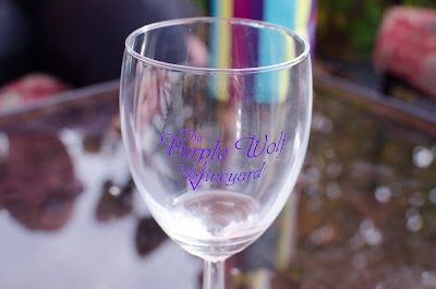 Sipping wine at Purple Wolf