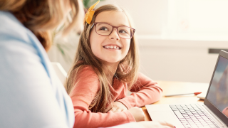 woman and young girl in front of laptop