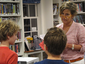 "Photo: Maureen quizzes the kids on their knowledge of ""Escape from Mr. Lemoncello's Library"""