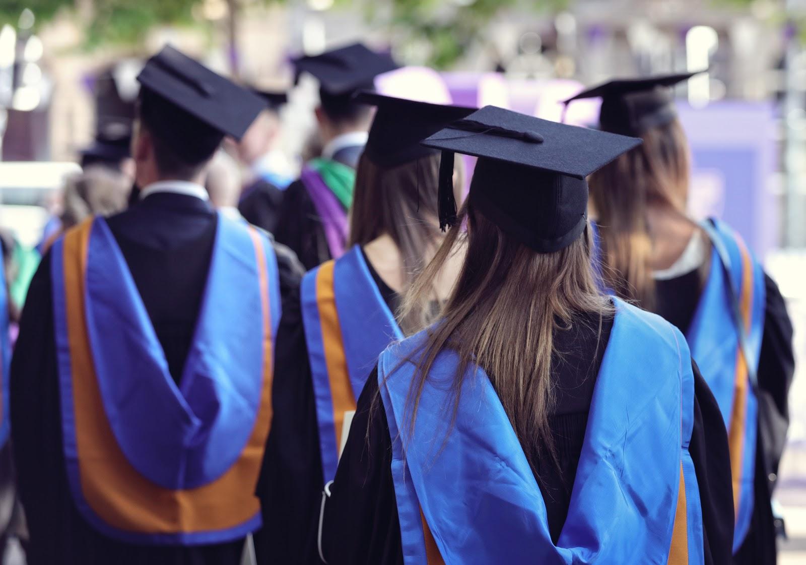 Doctorate vs PhD: Graduates wearing toga