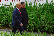 U.S. President Donald Trump and North Korean leader Kim Jong Un walk in the Capella Hotel after their working lunch, on Sentosa island in Singapore June 12, 2018.