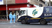 In this file photo, a  Fidelity vehicle at the scene of a cash-in-transit heist in Hillbrow, Johannesburg. The Hawks have arrested two former Fidelity employees who allegedly gave out information regarding the cash distribution vehicles' movements.