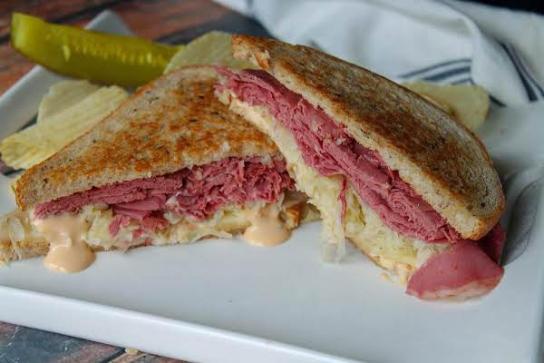 Reuben Sandwich On Rye With Dill Pickles.