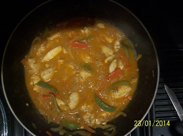 Taste the chicken and adjust the seasoning as necessary . Add the tomatoes ,stir...