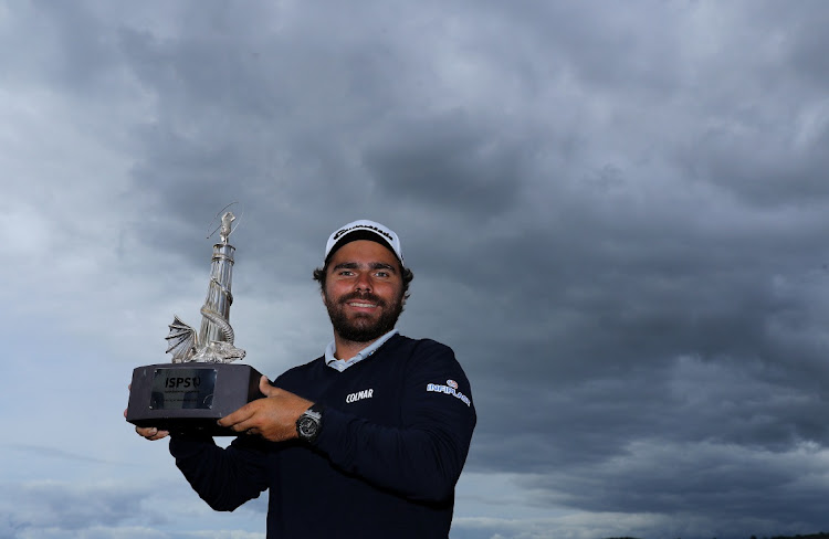 Romain Langasque of France poses with the trophy after winning during the Wales Open at the Celtic Manor Resort in Newport, Wales, August 23 2020. Picture: WARREN LITTLE/GETTY IMAGES