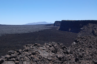 Photo: Looking back: the cabin atop the cliffs, with Mauna Kea in the distance.