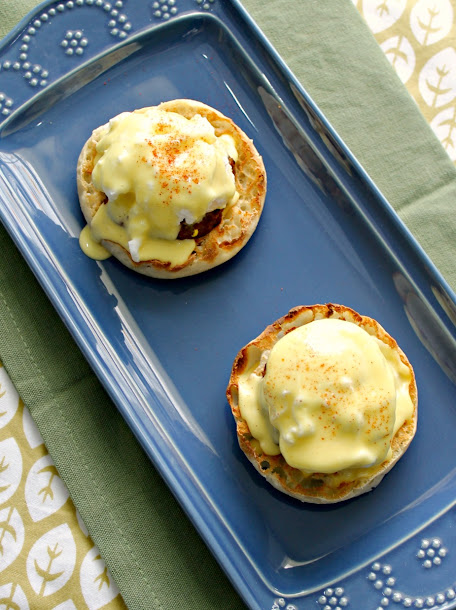 Easy Sausage Eggs Benedict recipe - perfect for Mother's Day brunch!  It's made even easier with precooked sausage patties and Hollandaise sauce made in the blender.